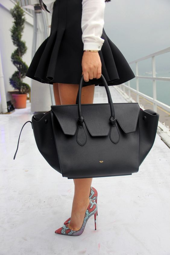 black purse with black skirt