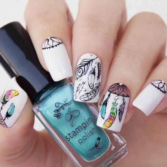 Elegant White Nails With Dreamcatcher Patterns picture 1