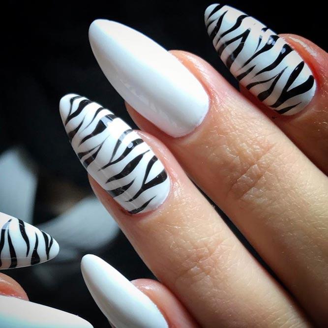 Animal Print Accents On Flawlessly White Base #blackandwhitenails #stripesnails #almondnails #longnails